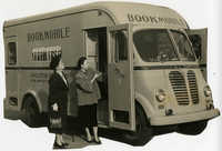 Emily Sanders and Mary McBee examime bookmobile