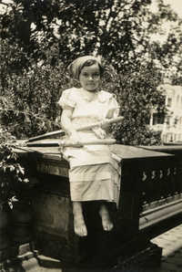Girl in costume on porch of Main Library (1)