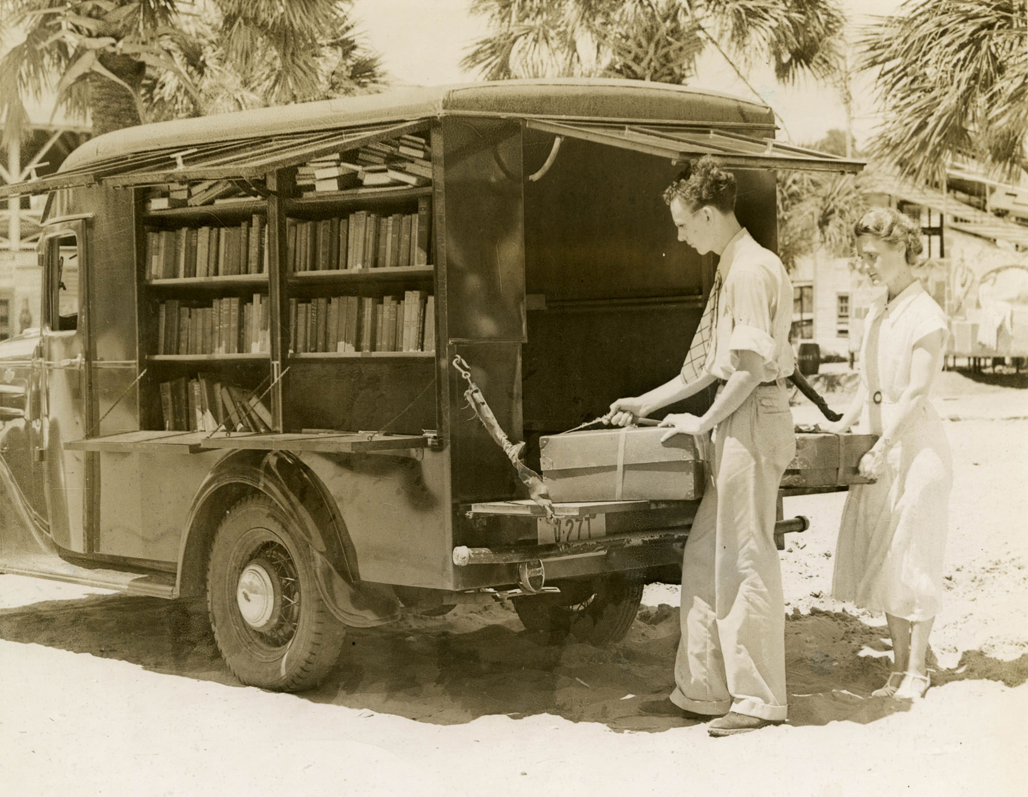 Bookmobile stopped on an unidentified beach