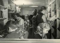 Readers browsing books in bookmobile