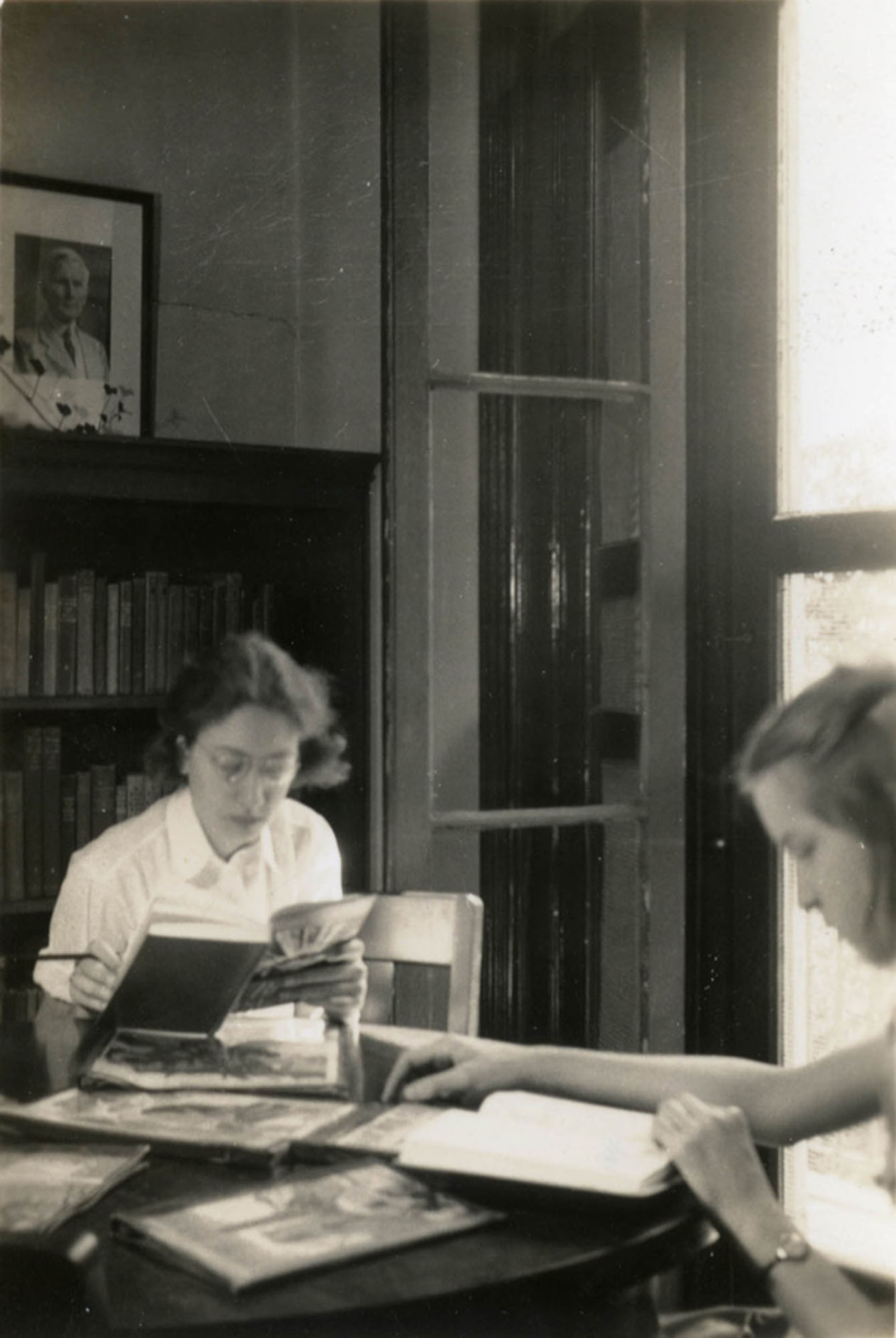 Young women reading in Children's Room, Main Library (1)
