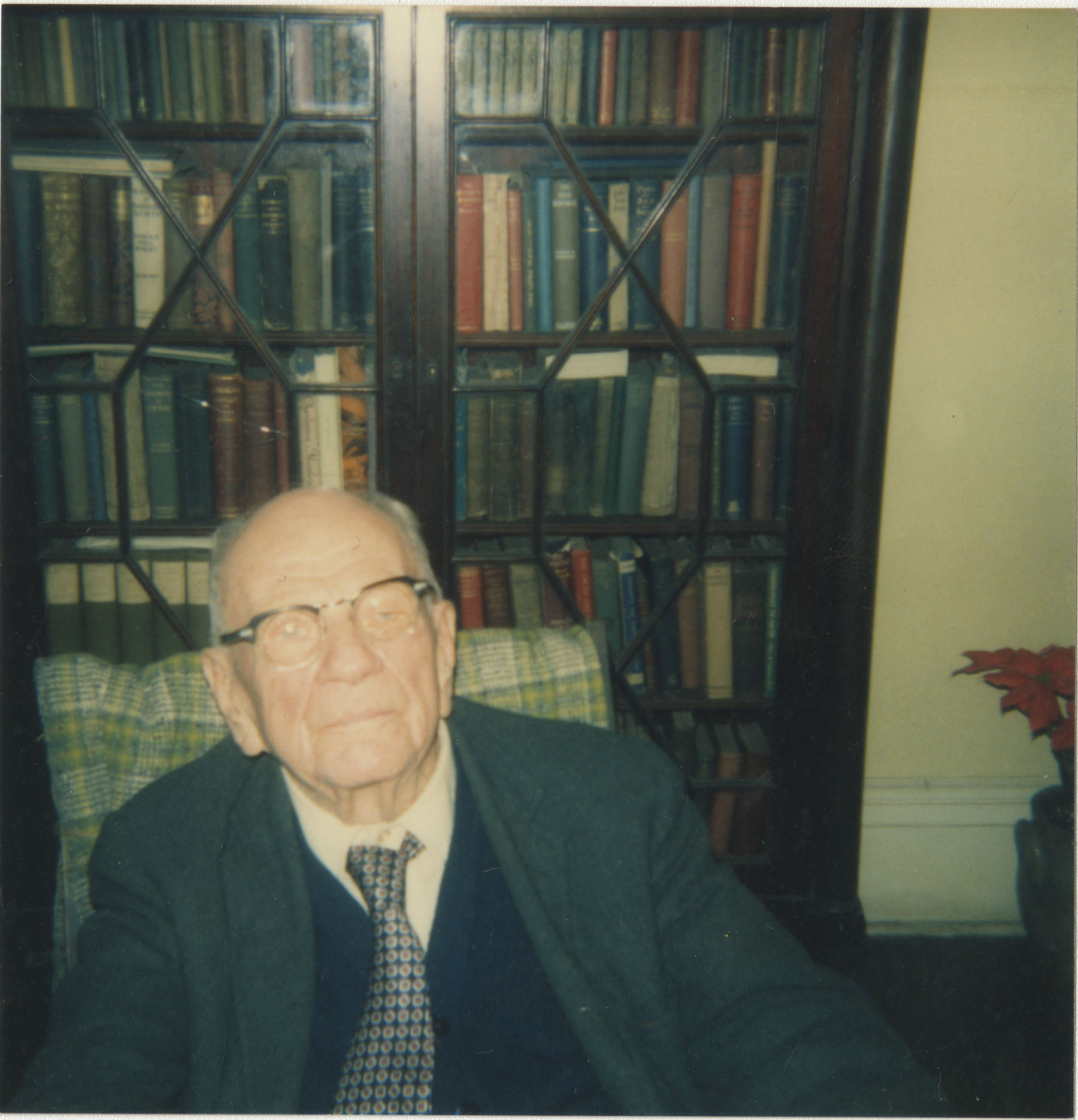 Willie McLeod in Front of Bookcases