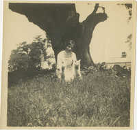 Woman in Grass with Pets