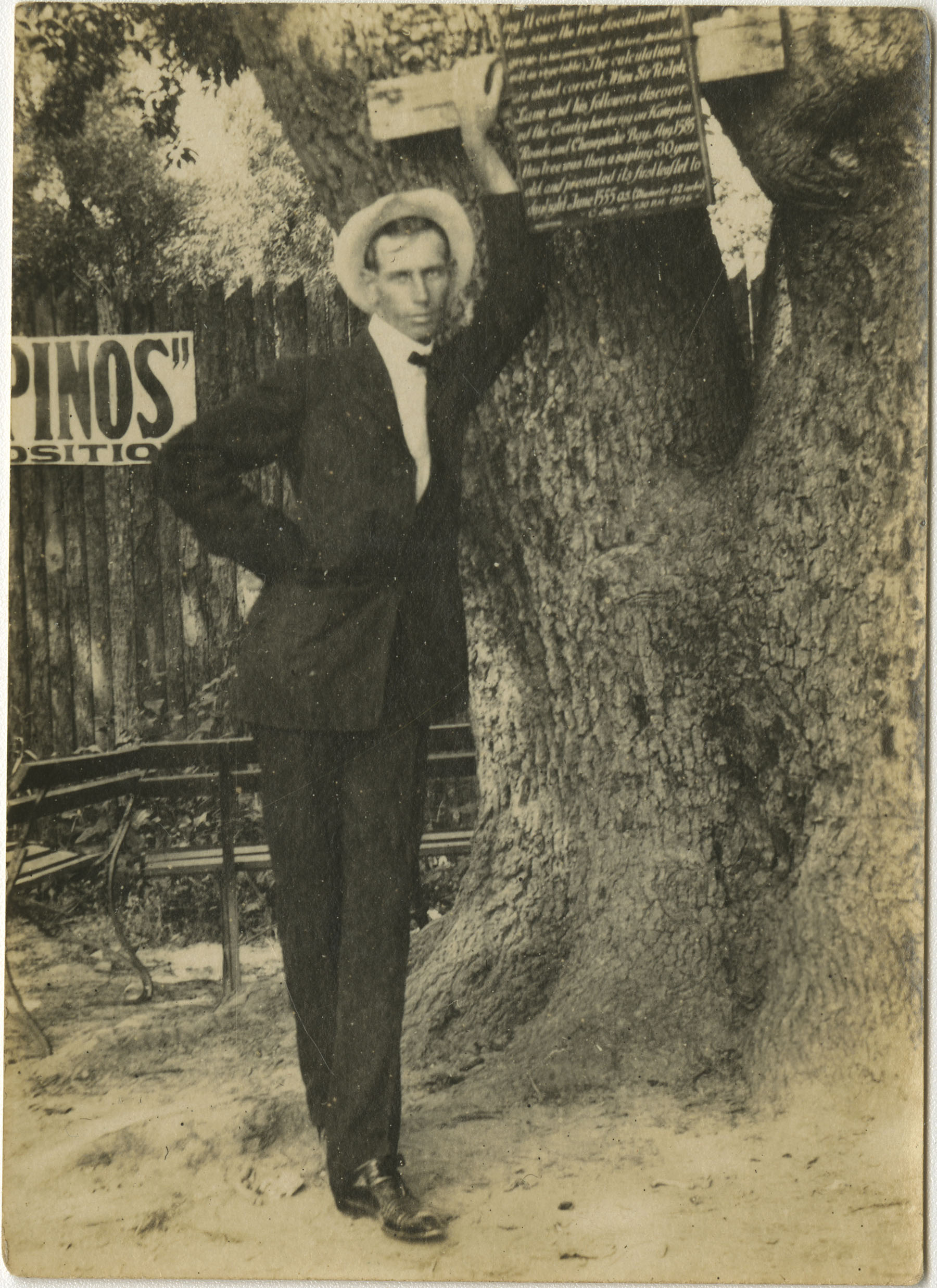 Man Leaning Against Tree