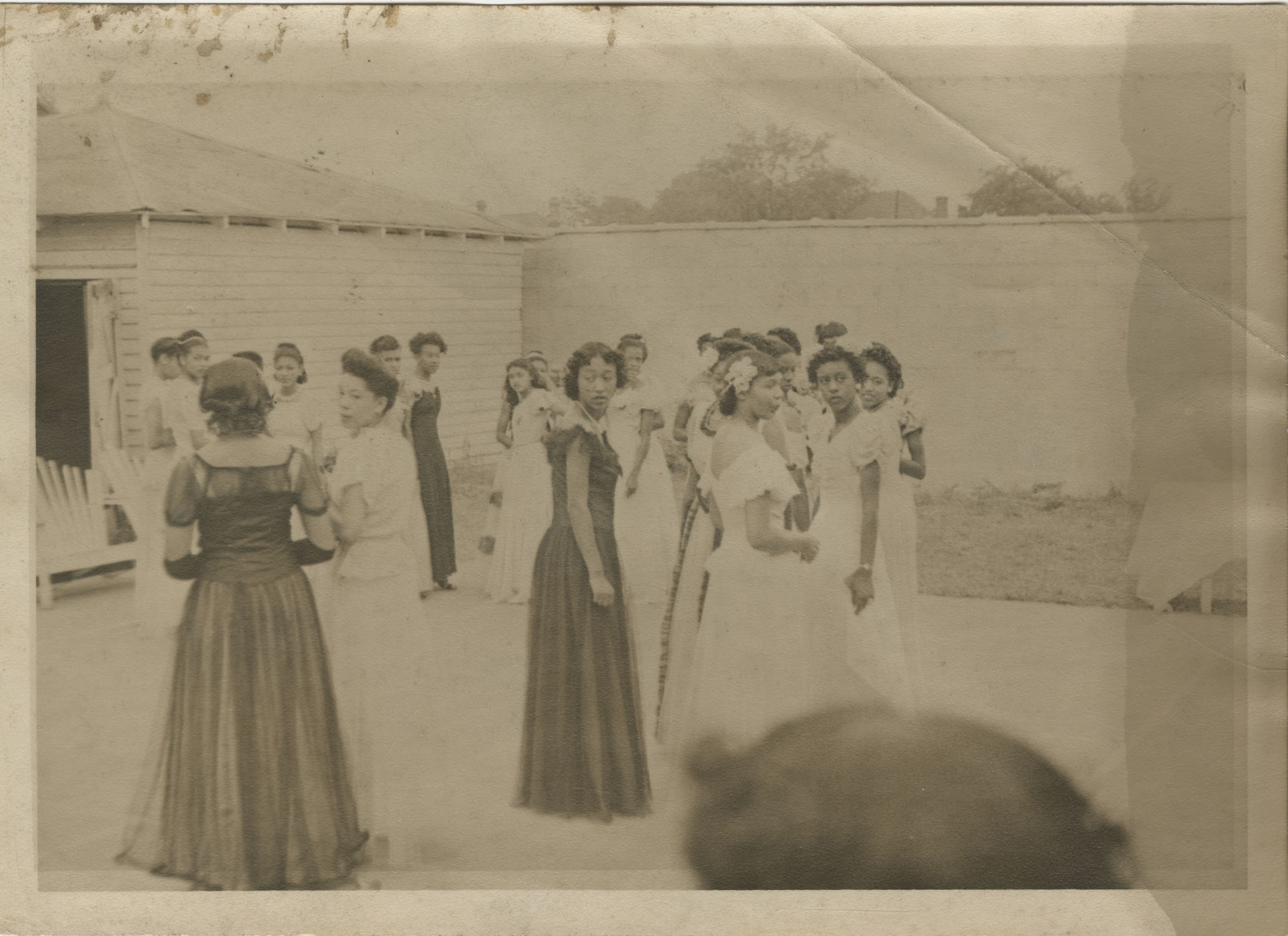 Debutantes Mingling in a Courtyard, 1948