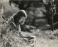 Young Woman Reading Outdoors, University of California, Santa Cruz