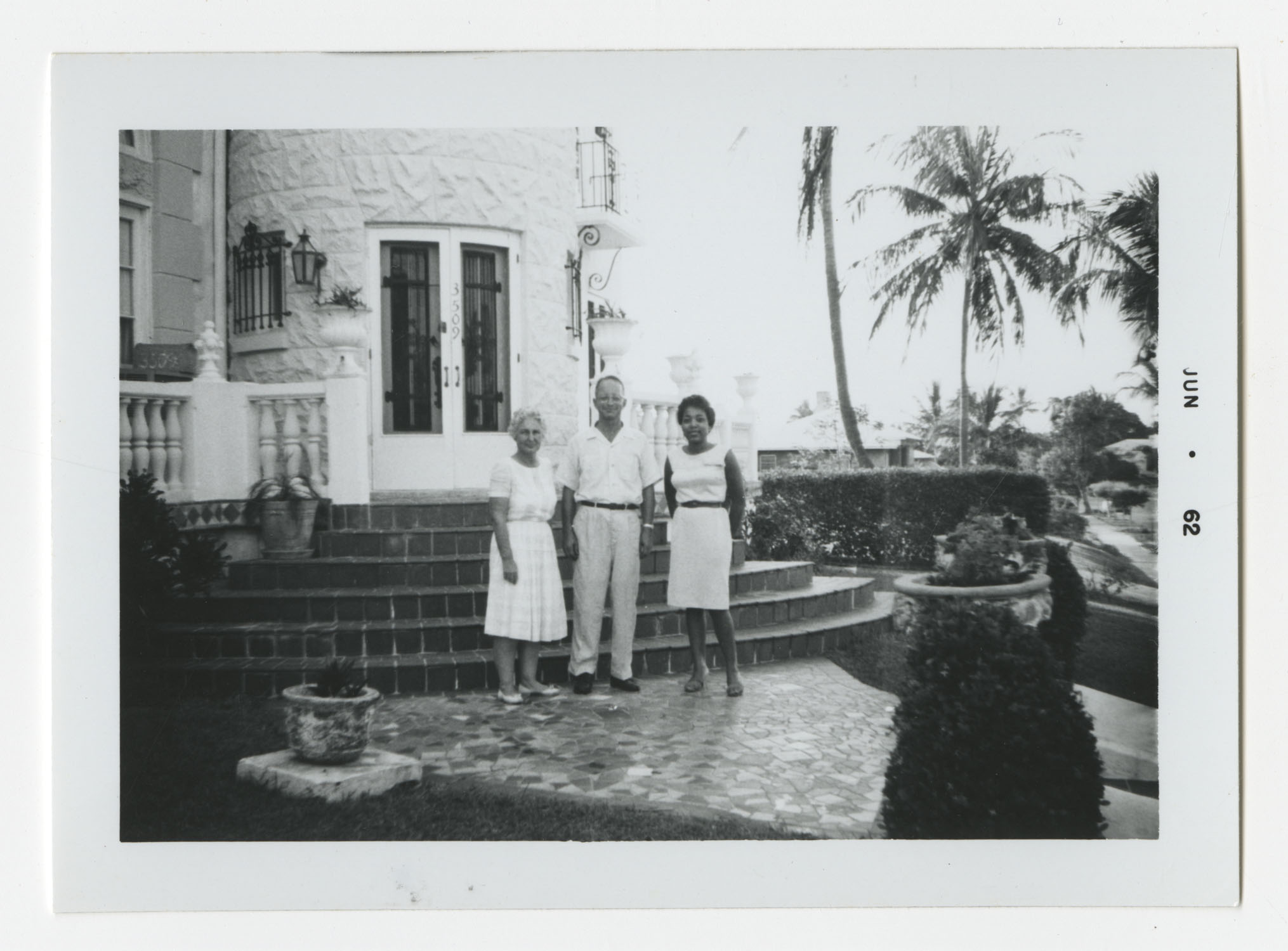 Three People Standing Outside of a House, June 1962