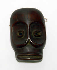 Smoked ivory ornamental face mask