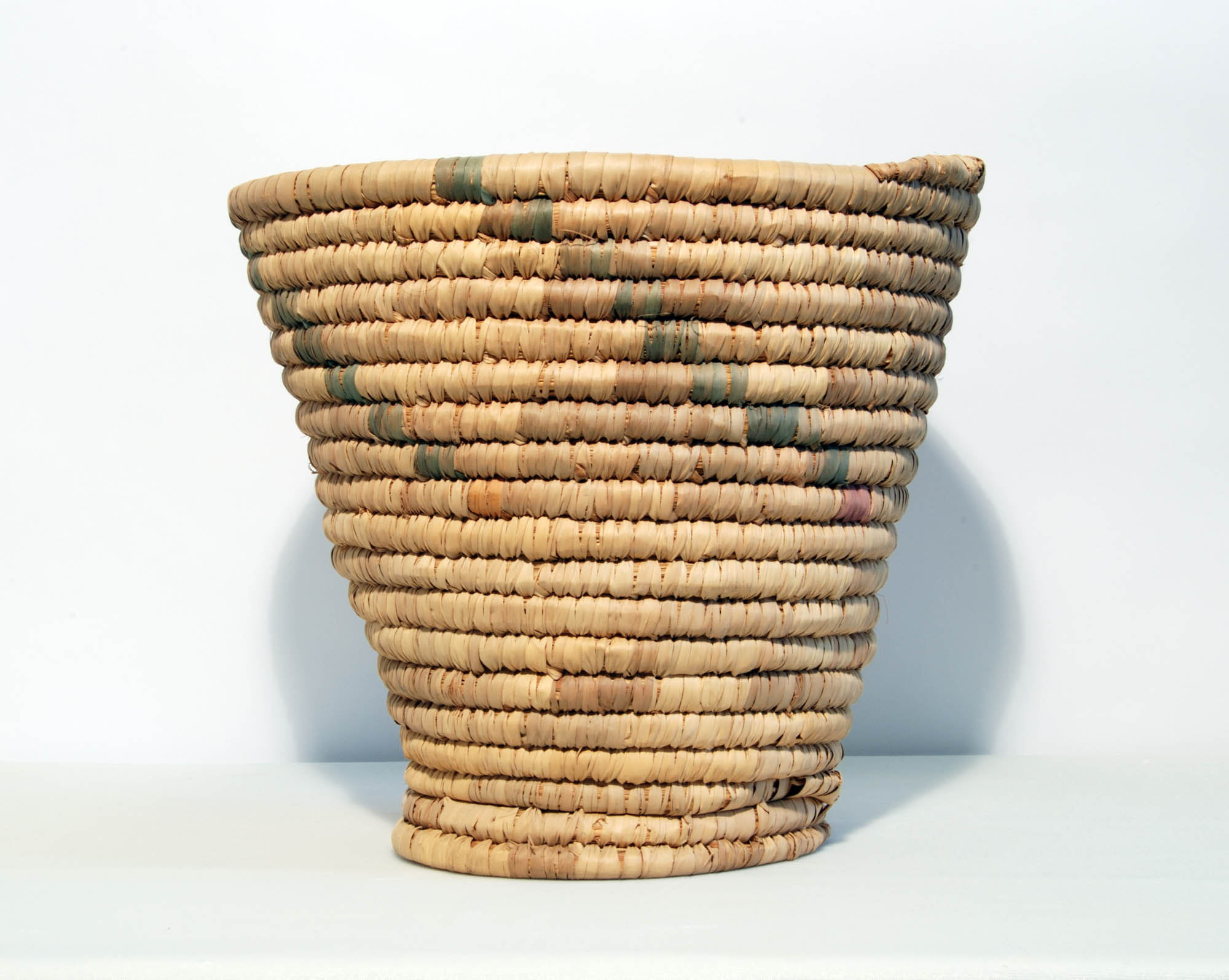 Coiled grass basket