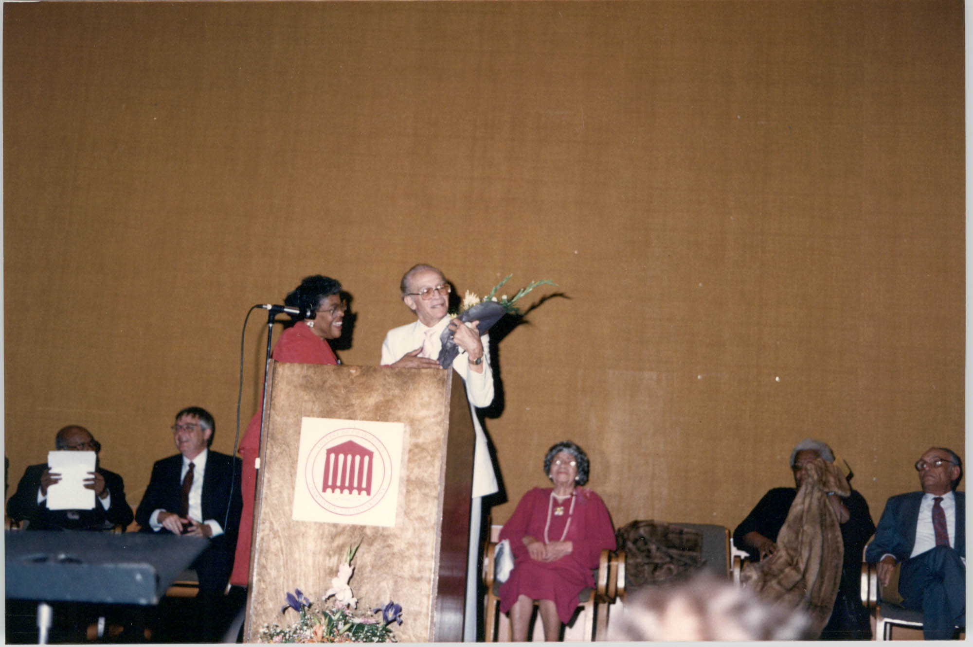 Photograph of Eugene C. Hunt Receiving Flowers at a College of Charleston Event