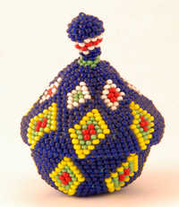 Coiled beaded basket