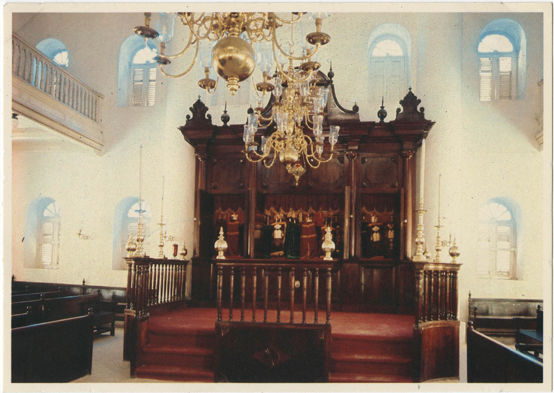 Curaçao, Netherlands Antilles. Interior of Mikve Israel-Emmanuel Synagogue, dedicated in 1732, oldest in continuous use in Western Hemisphere. View shows mahogany Hekhal (older than the building itself) containing 18 scrolls and beautiful old brass chandeliers over sand covered floor.