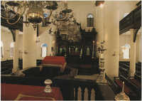 Curaçao, Netherlands Antilles. Interior of Mikve Israel-Emmanuel Synagogue, dedicated in 1732, oldest in continuous use in Western Hemisphere. View shows mahogany Hekhal containing 18 scrolls and beautiful old brass chandeliers over sand covered floor.