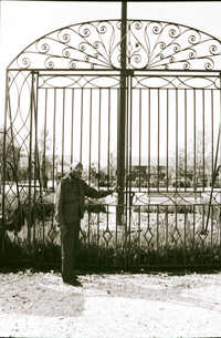Philip Simmons standing in front of the gate at the Charleston Visitor Center.