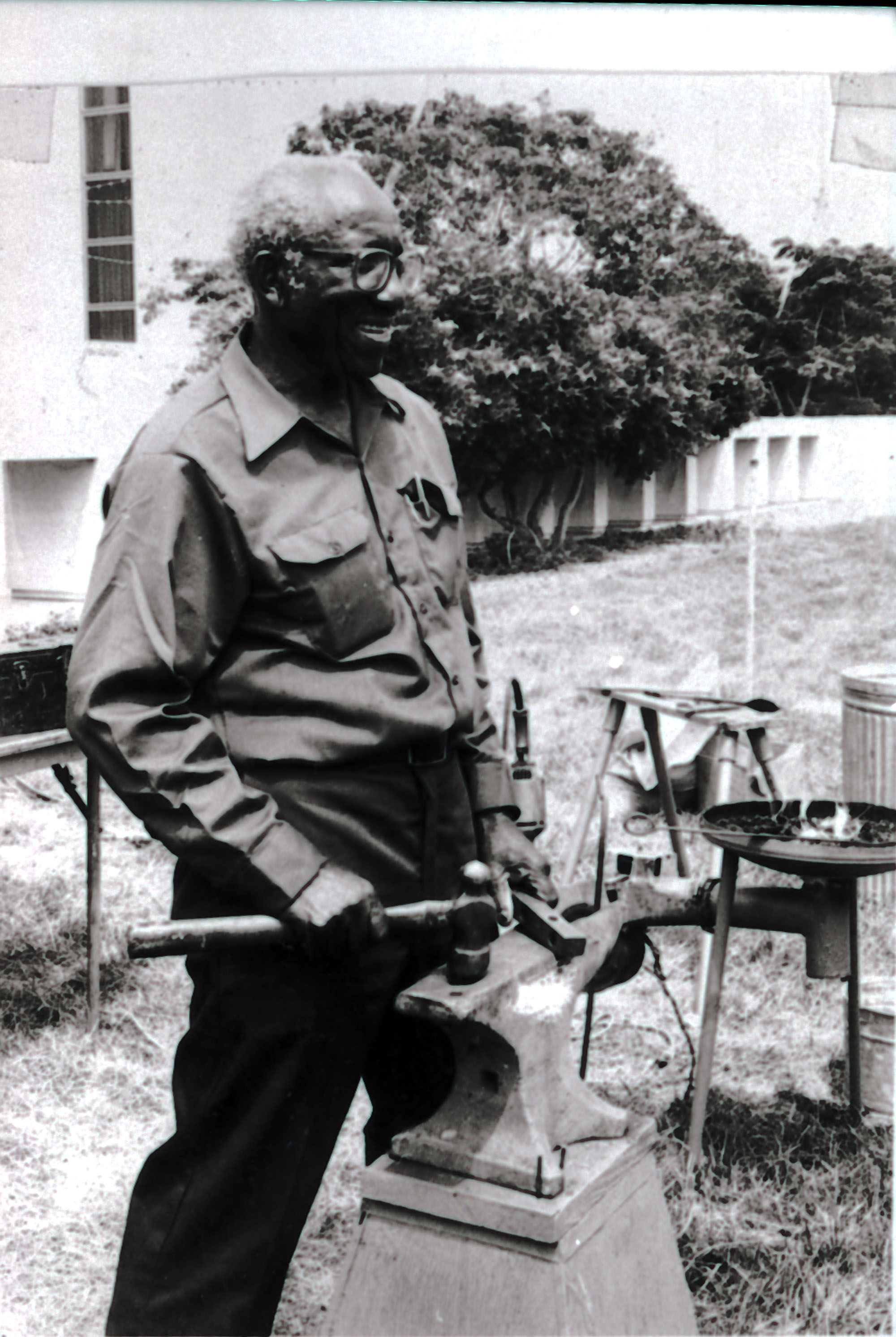 Philip Simmons with three pieces of equipment.
