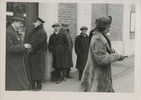 Unidentified persons waiting in line