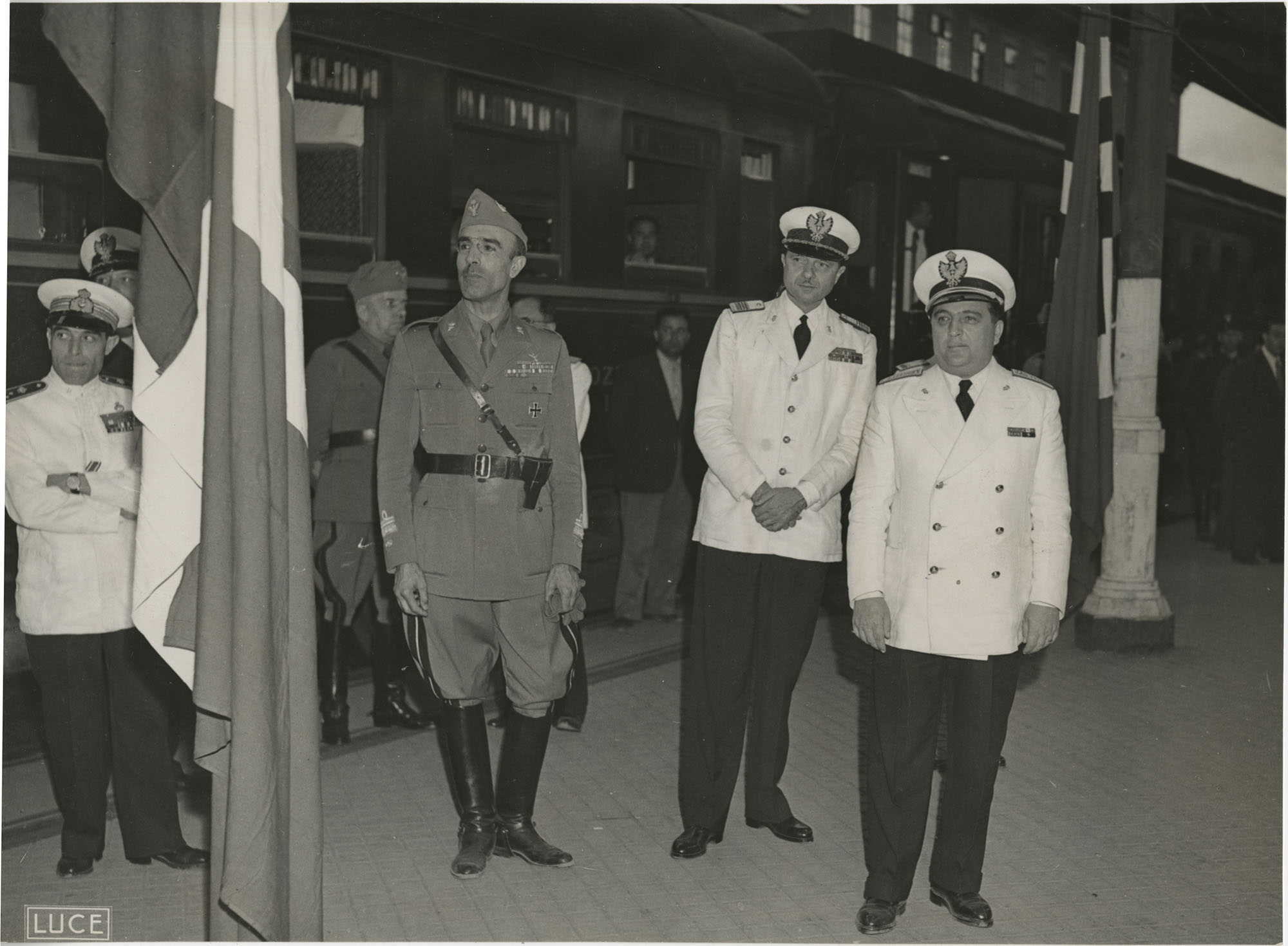 Mario Pansa and military officials at a train station, Photograph 3