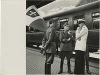 Mario Pansa and military officials at a train station, Photograph 2