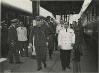 Military officials at a train station, Photograph 13