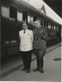 Military officials at a train station, Photograph 8