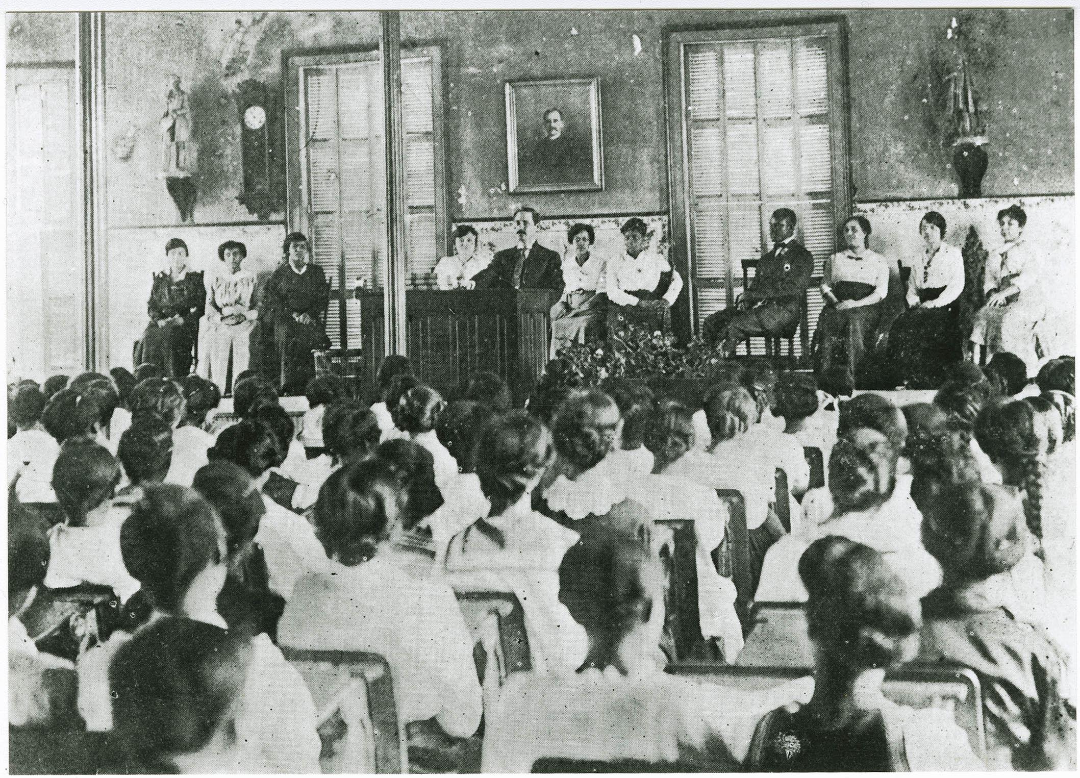 Principal Cox addressing studentbody in Avery auditorium