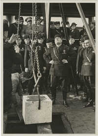 Benito Mussolini witnesses the laying of the foundation for the film industry in Rome, Italy