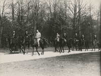 Mario Pansa and unidentified persons astride horses, Photograph 5