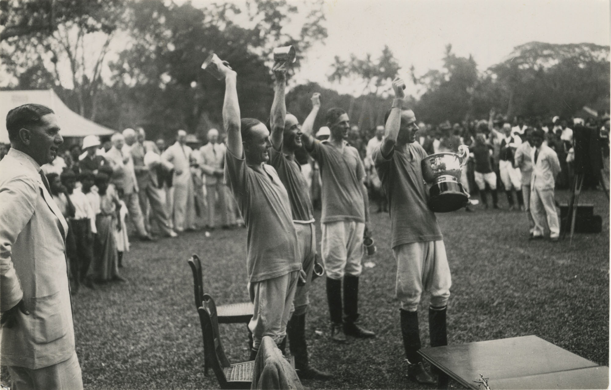 Mario Pansa celebrating with his polo team, Photograph 2