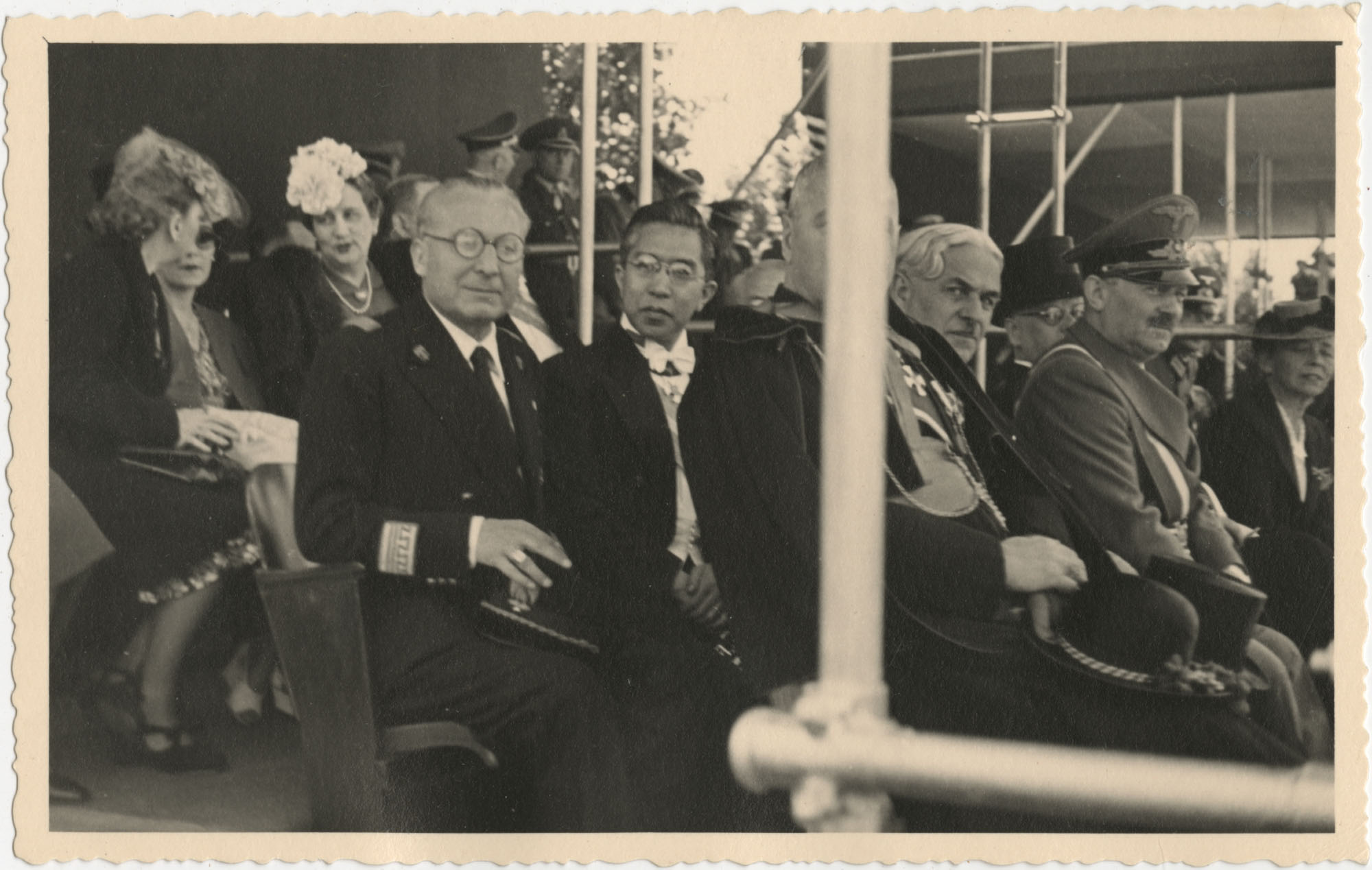 Japanese Emperor Hirohito and other officials observing a military ceremony, Photograph 1