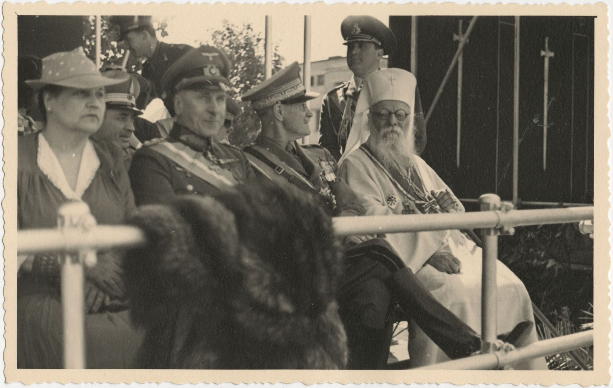 Officials observing a military ceremony, Photograph 2