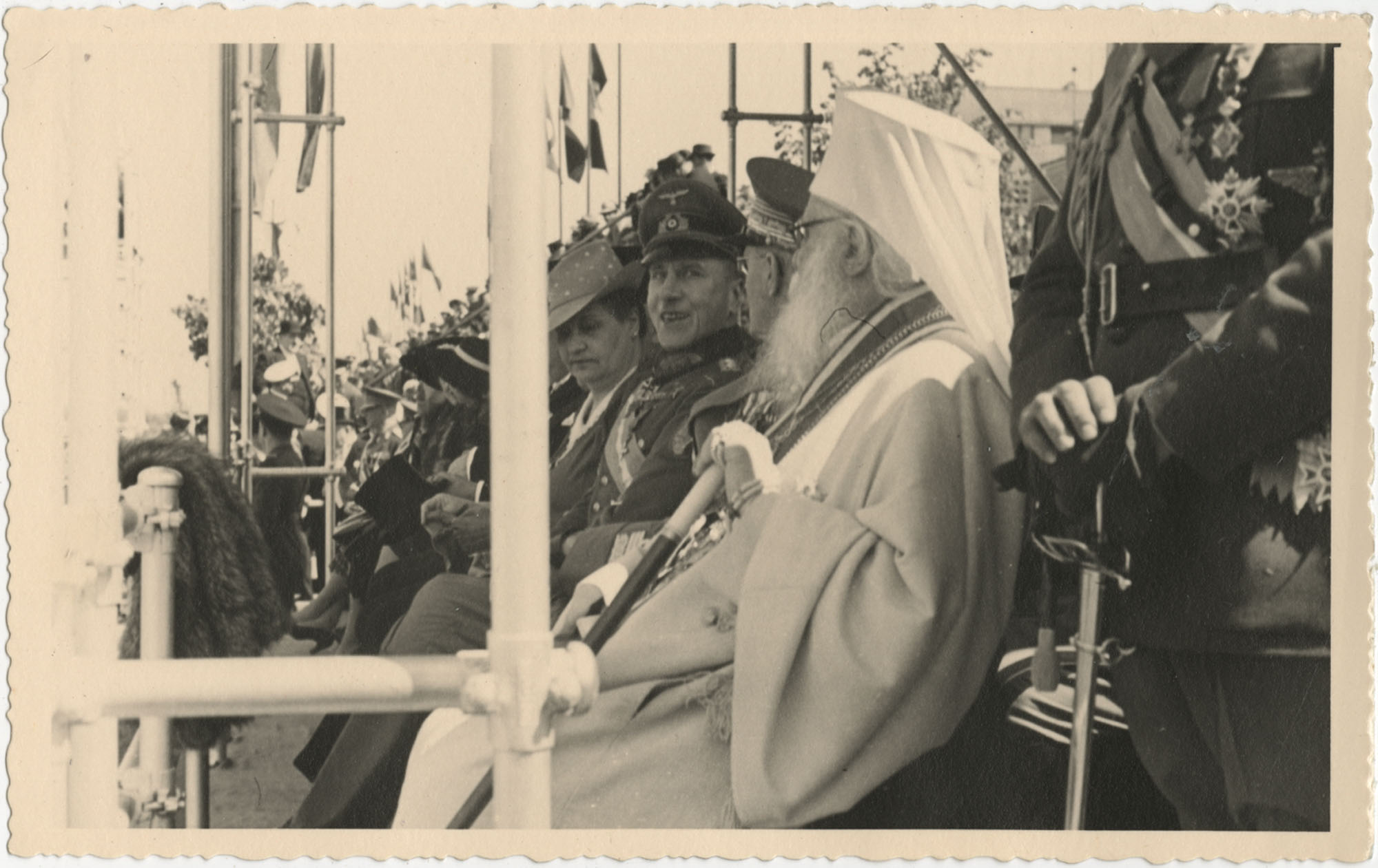 Officials observing a military ceremony, Photograph 3