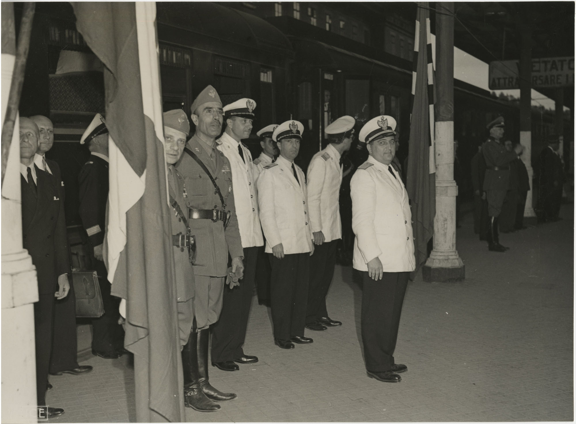 Military officials at a train station, Photograph 14