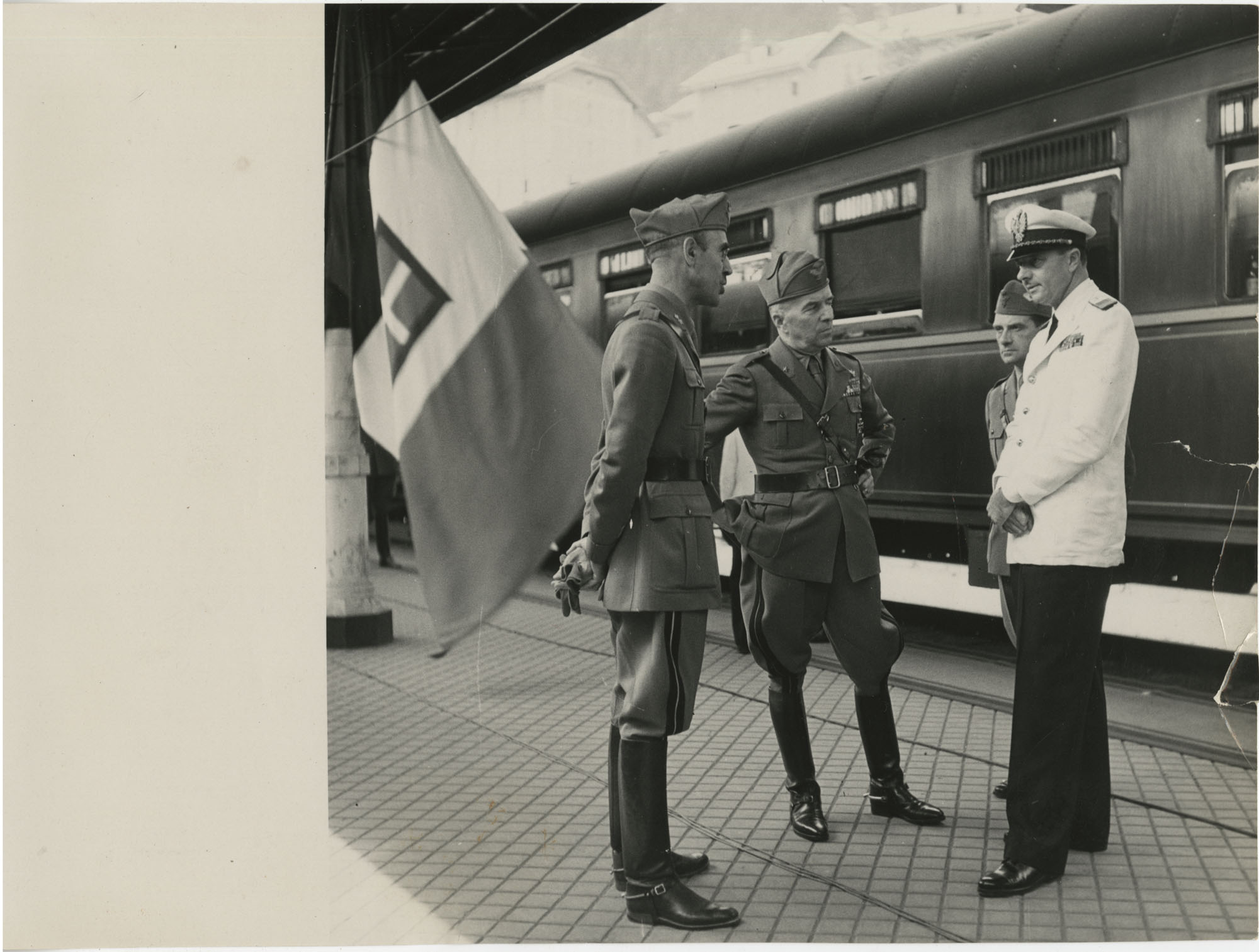 Mario Pansa and military officials at a train station, Photograph 1