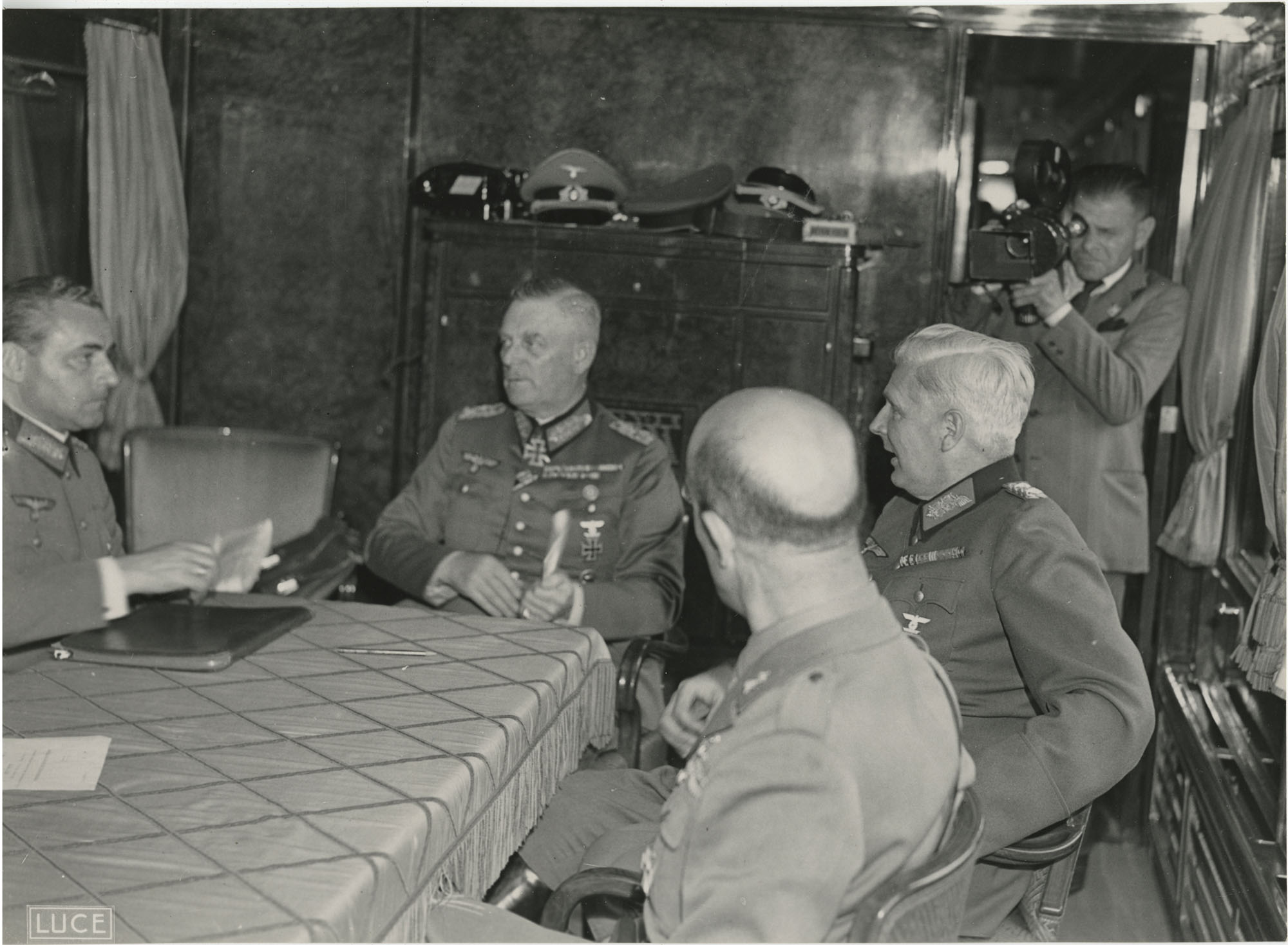 Military officials at a train station, Photograph 4