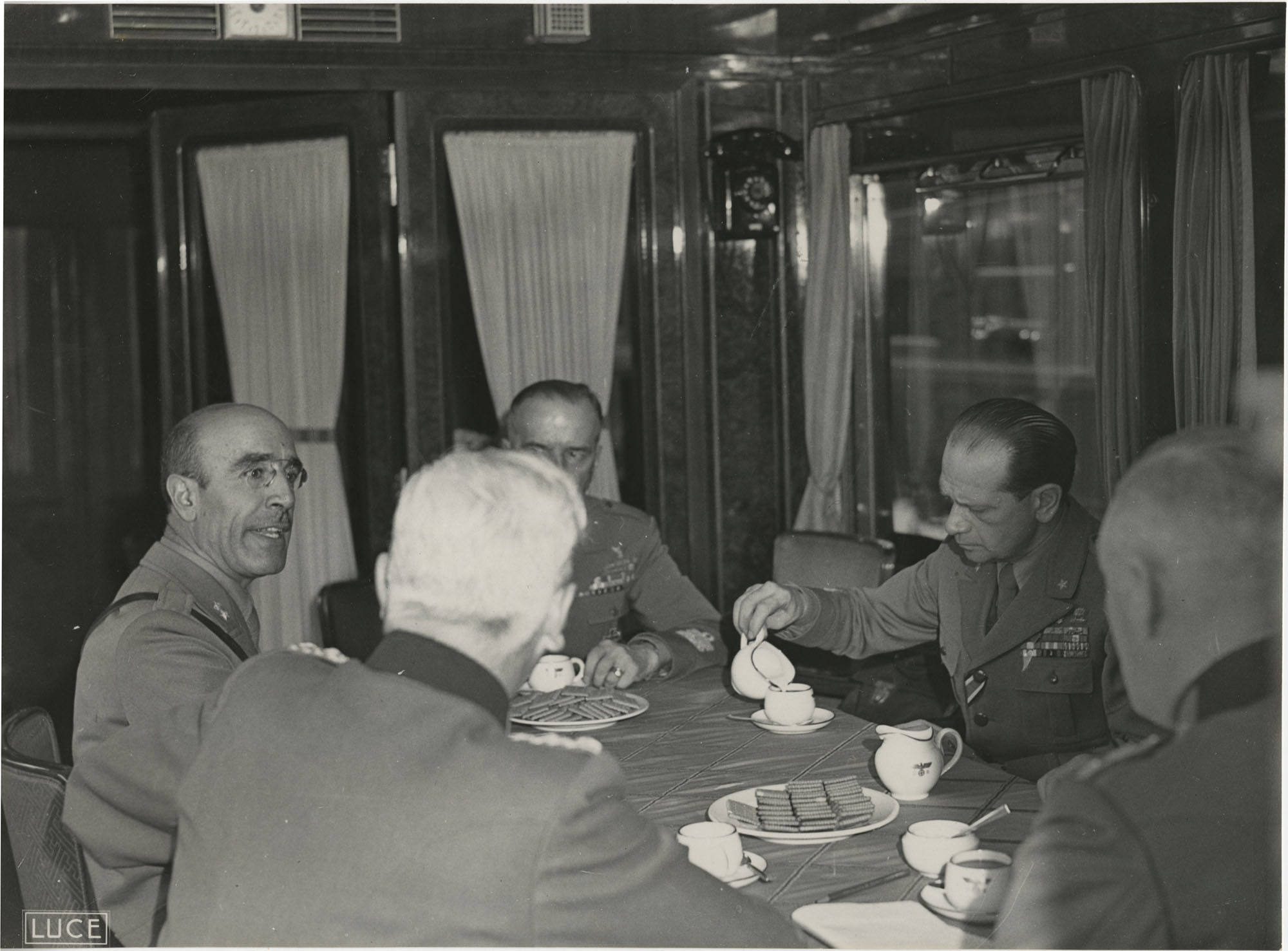 Military officials at a train station, Photograph 6
