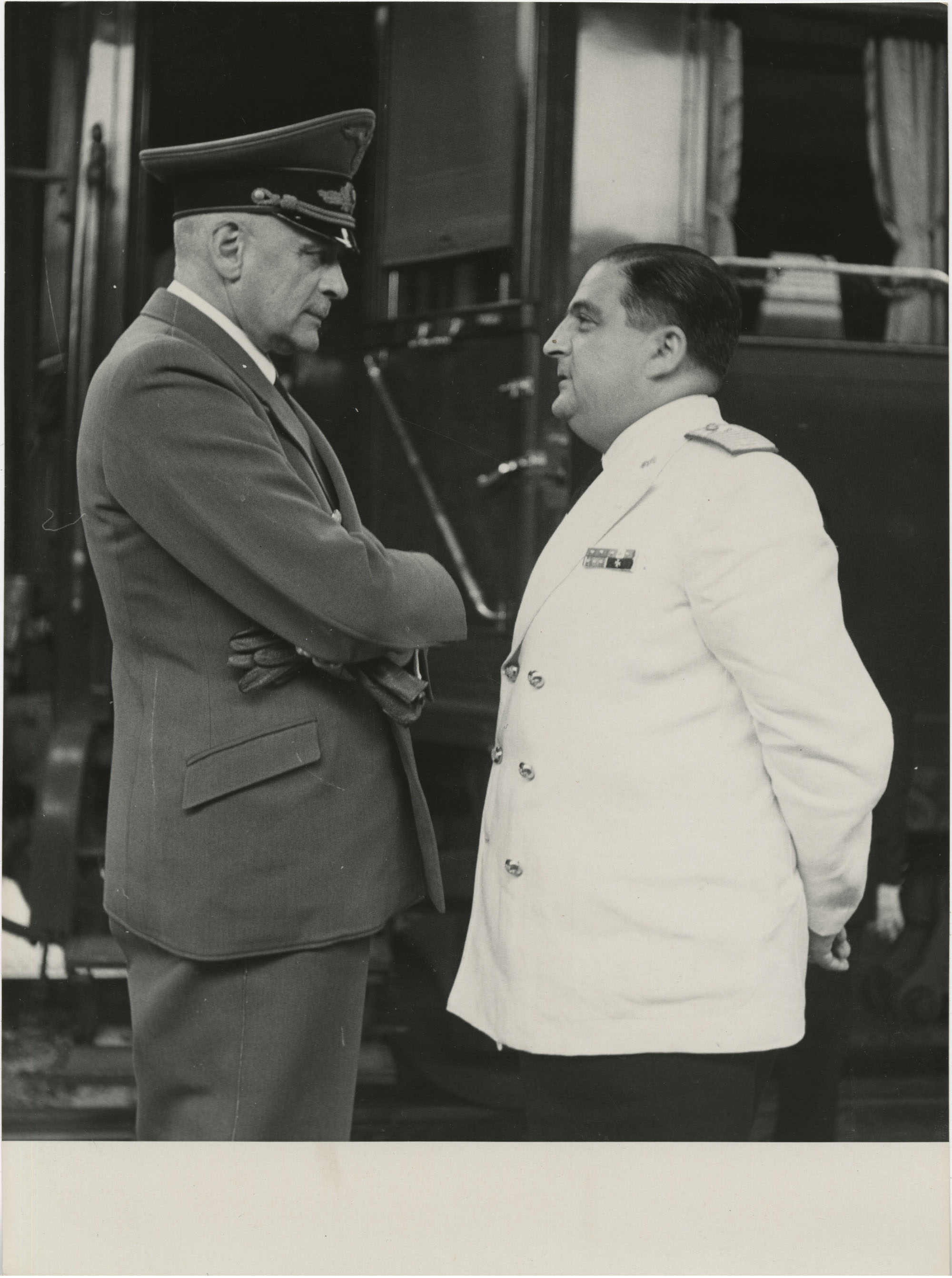 Military officials at a train station, Photograph 2
