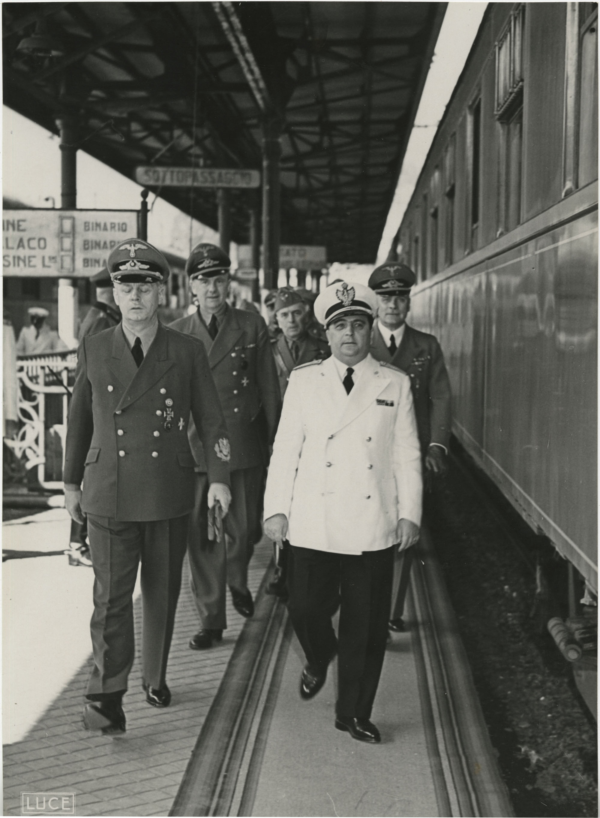 Military officials at a train station, Photograph 1