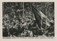 Italian forces marching through an Ethiopian town