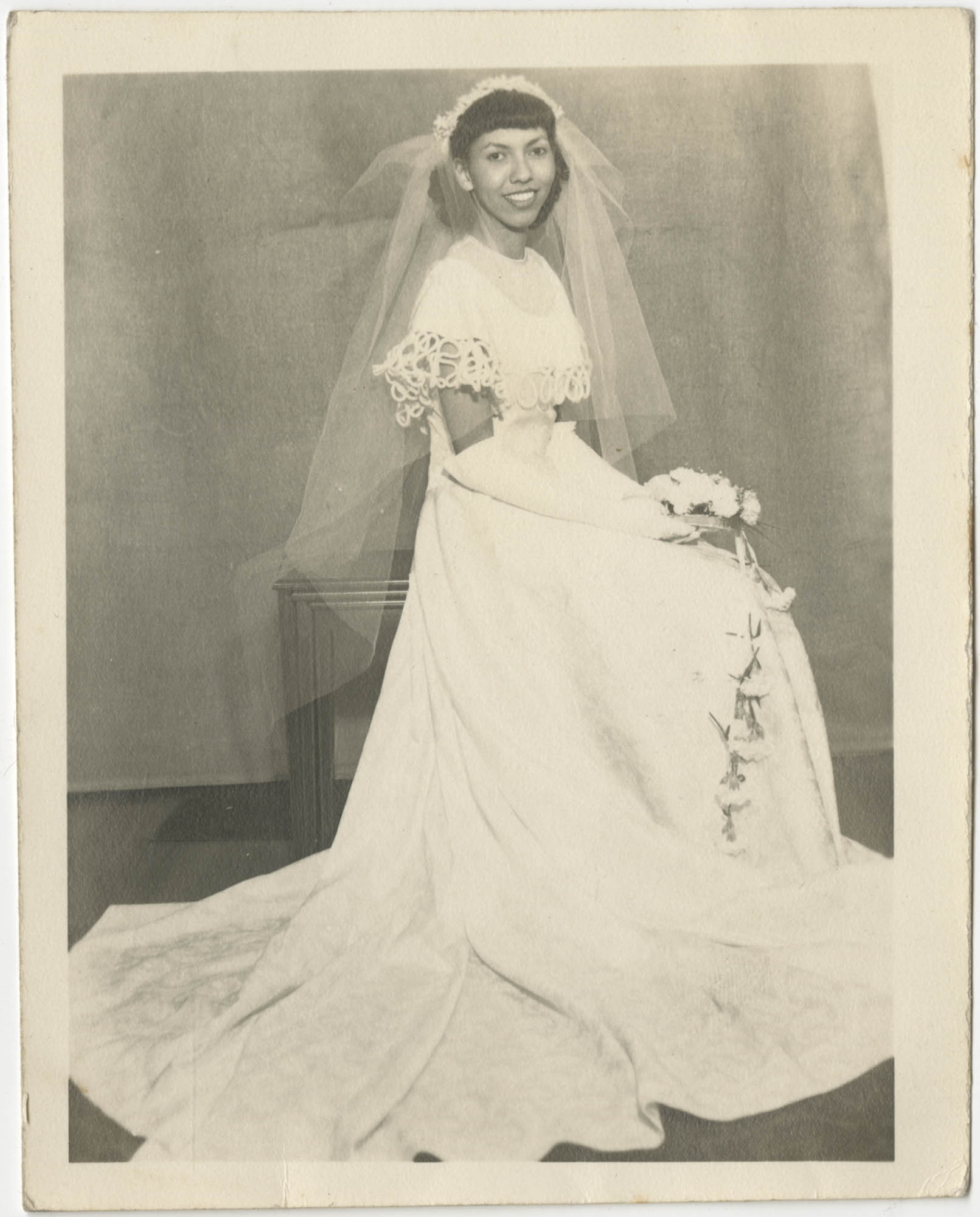 Photograph of a Woman Wearing a Wedding Gown