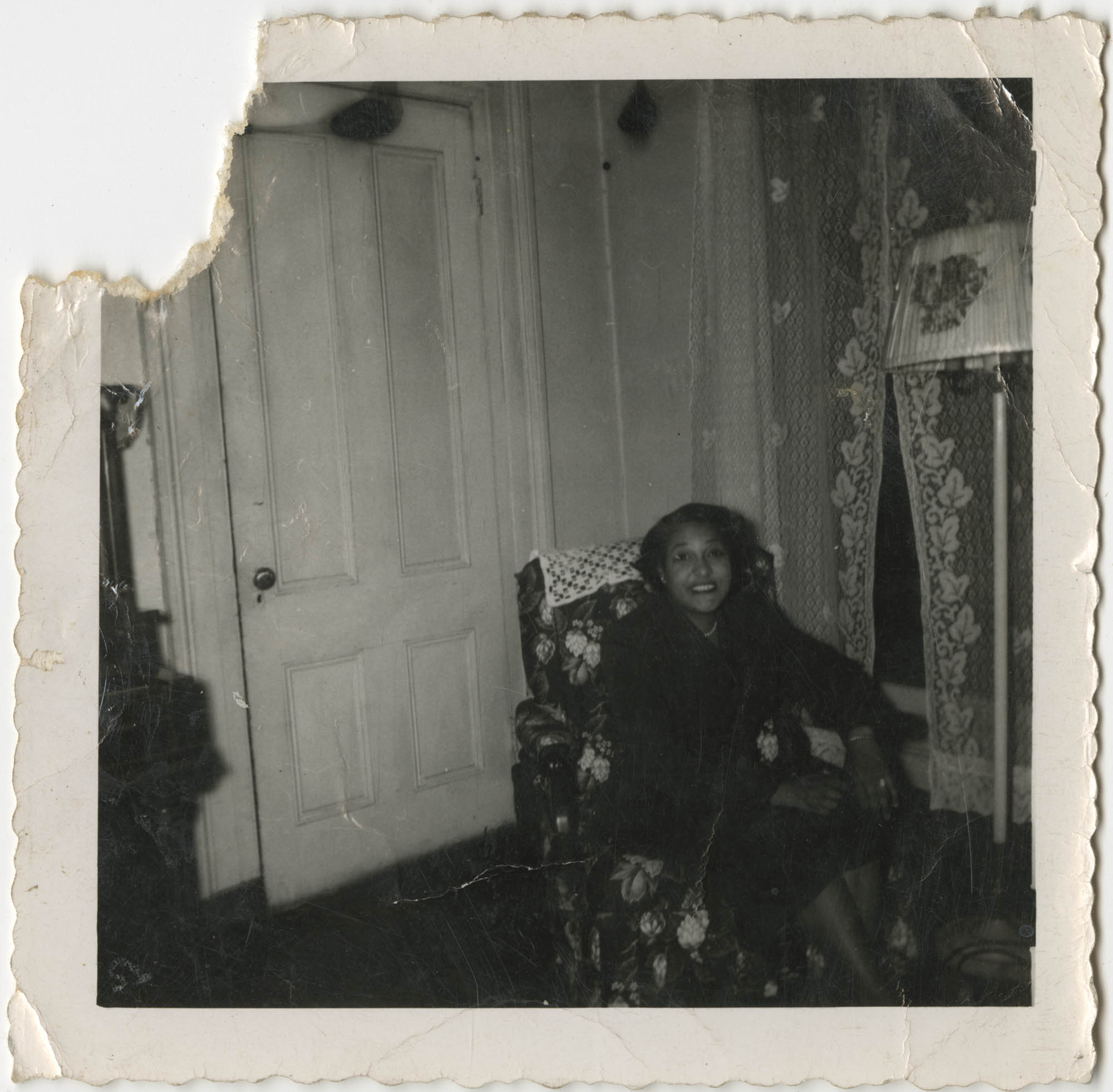 Photograph of a Woman Seated in a Living Room