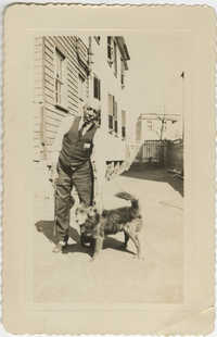 Photograph of a Man and Dog