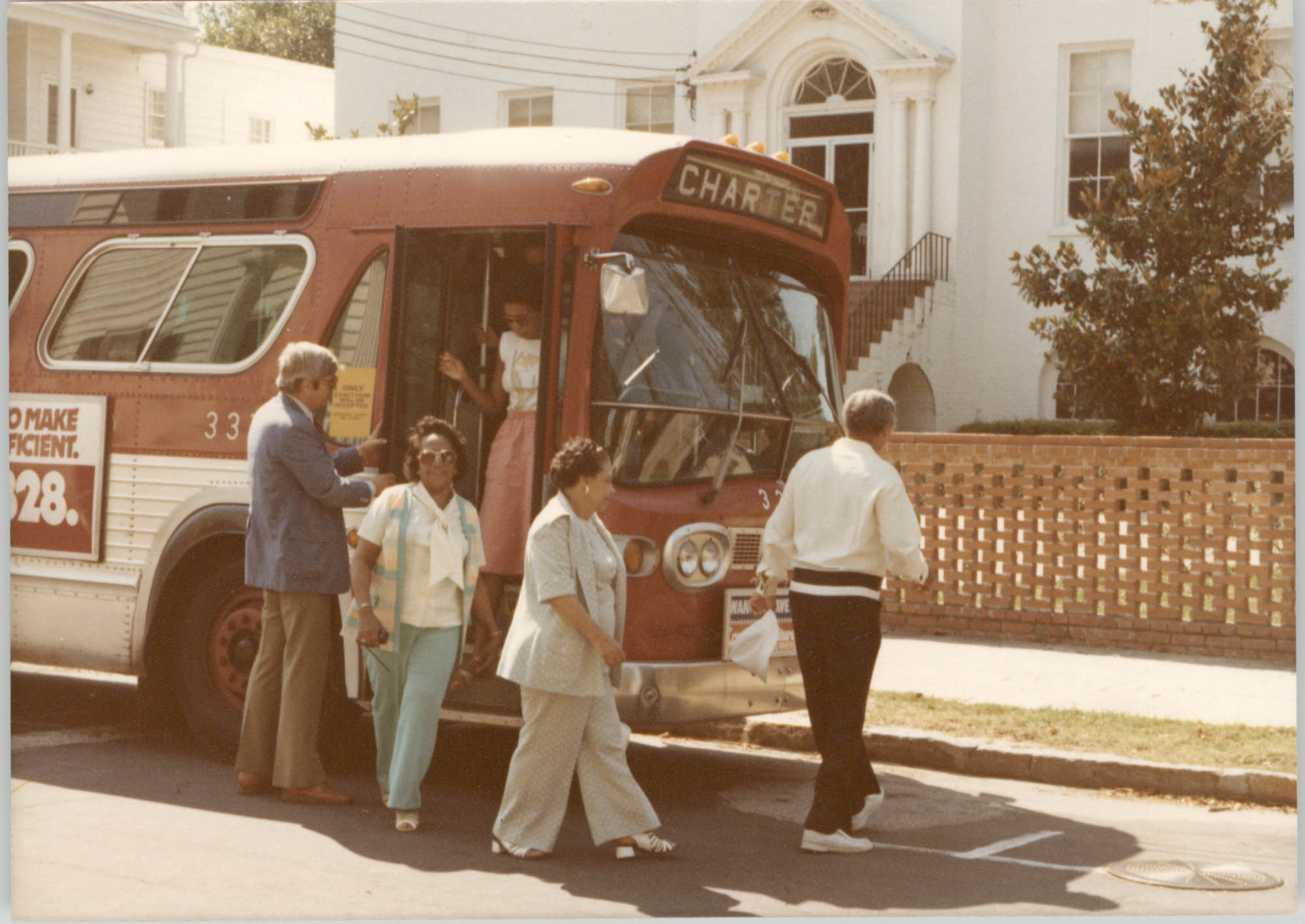 Photograph of People Exiting a Bus