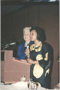 Photograph of Two Women at a Podium