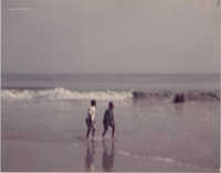 Photograph of Two People on a Beach