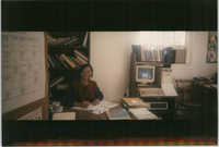 Photograph of a Woman Seated at a Desk