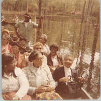 Photograph of a Group of People on a Boat