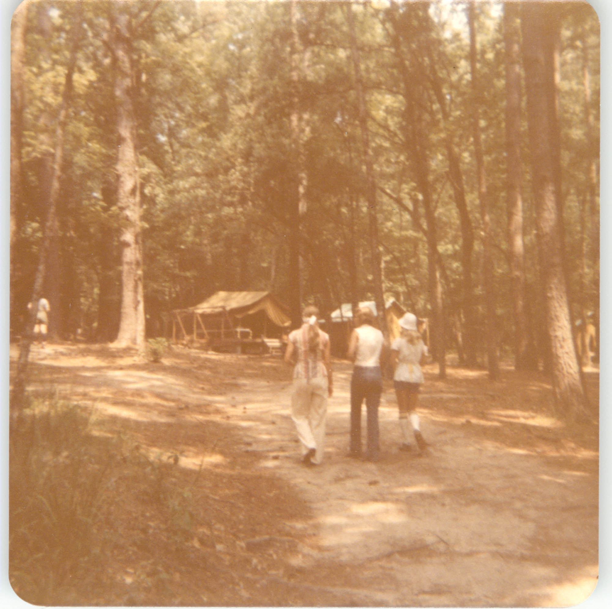 Photograph of Three People Walking