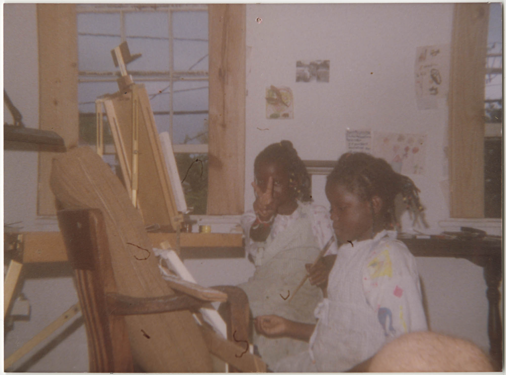 Photograph of Two Girls Painting