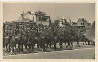 Soldiers astride horses in a military ceremony