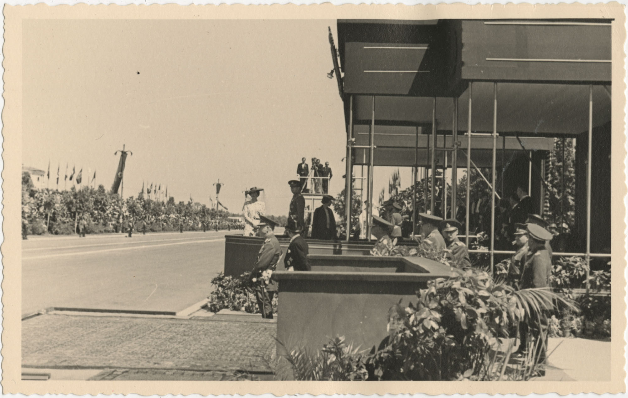 Officials observing a military ceremony, Photograph 5